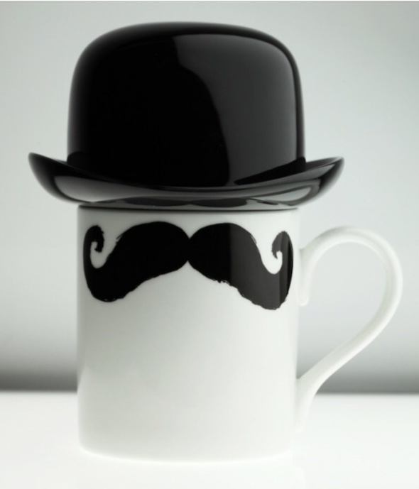 White mug with a moustache print and a lid shaped like a bowler hat